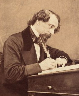 Author of the poignant, 'Tale of Two Cities,' Charles Dickens at his desk in 1858.
