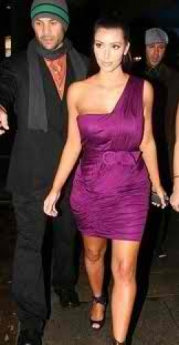Kim Kardashian is stunning in this purple one armed dress.