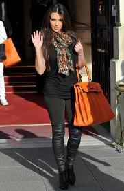 Kim absolutely loves the Hermes Birkin Bag, he she is sporting it in rust.