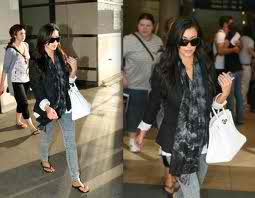 Here's Kim with another Hermes bag in White.