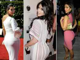 Here's Kim's very favorite pose. She shows off her fabulous figure in these fly dresses.