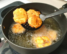 Tostones in frying pan (after they've been smashed)