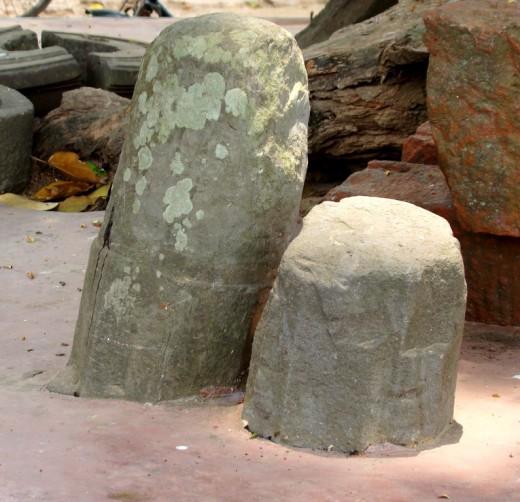 Two ancient stone Shiva Lingams