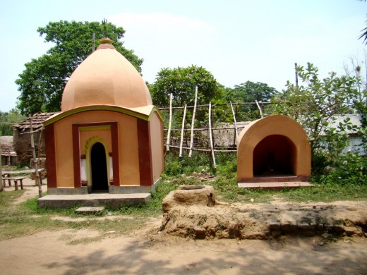 The Ek Ratna temple of Har-Parvati & the small cave -like temple of Shiva