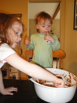 My two girls licking the cake batter the morning of my two-year-old's birthday.  They had batter up to their elbows and all over their faces.  Isn't this the fun part of baking?