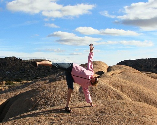 Ardha Chandrasansa, Balancing half Moon in Joshua Tree. Lisa Ware of Yoga 4 Love on family vacation Christmas 2008.
