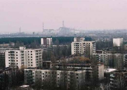 The town of Pripyat, hazily overlooking the Chernobyl Plant.