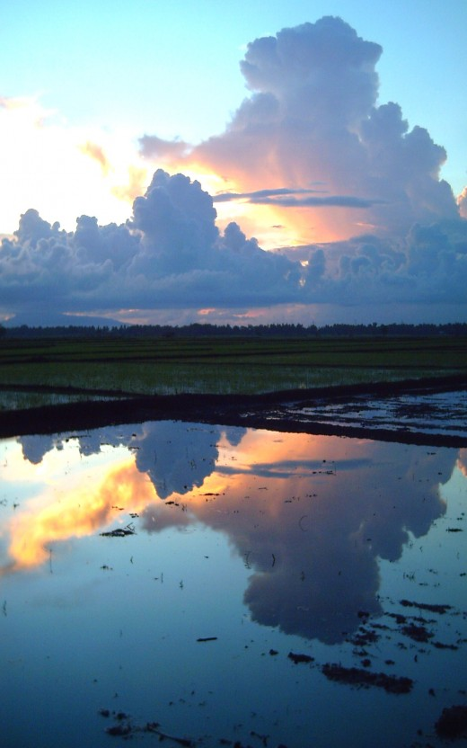 Clouds reflection during sunset (Photo by Travel Man)