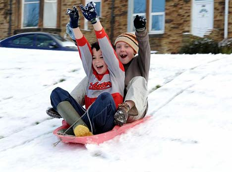 Sledding down a snowy hill is a great way to spend a snow day!