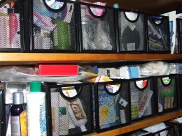 I took all the linens out of the linen closet. Put them in a cedar chest and measured the vertical space of the shelves. I hunted for containers that I would be able to see what was inside and at the same time be able to pull out for easy access.