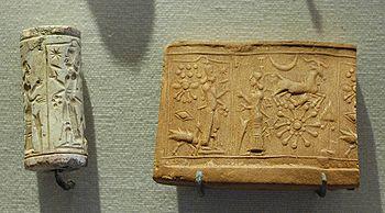 Mesopotamian limestone cylinder seal and impressionworship of Shamash, (Louvre).