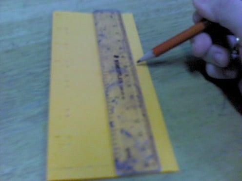 Measure yellow paper 5cm x 15cm (h x l ).  Cut it out.