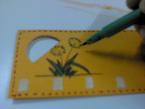 Draw flowers or anything on the yellow paper with markers.