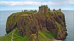 The Dunnottar Castle in Scotland bears a striking resemblance to the castle in my dream