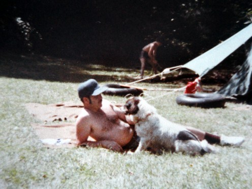 My father enjoying the companionship of our family dog, Thumper.  My brother is in the background messing around with the tent.