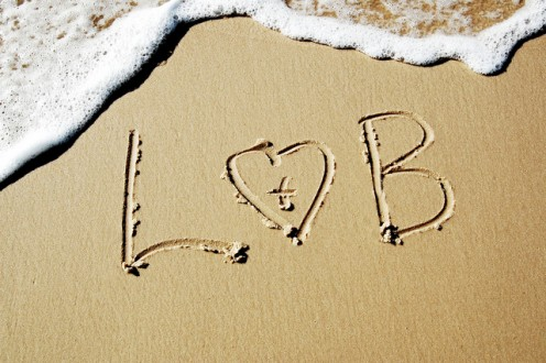 Waves may wash away the letters, but the sands of time can never wash away your love.  CCL A