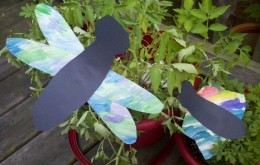 A completed dragonfly and butterfly enjoy the garden.