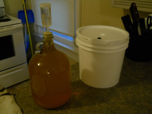 A secondary (left) fermenter next to a primary (right) fermenter.