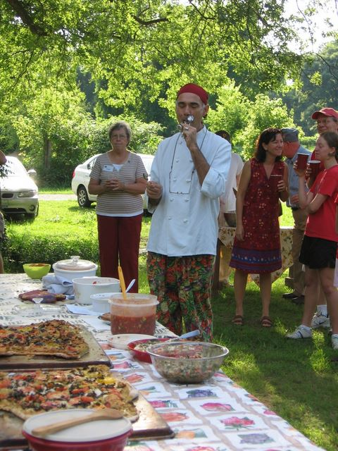 Chef Jacques tests a recipe during the annual Tomato Fest contest