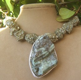 """""""Nugget"""" iron pyrite beads with large wire wrapped, raw emerald pendant.  This is a bold fashion statement!"""