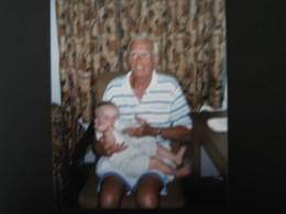 Dad holding Great Grandchild #3:  Grace