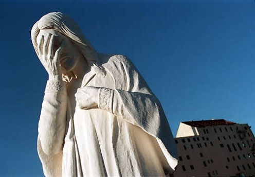 Marble statue of Jesus weeping.