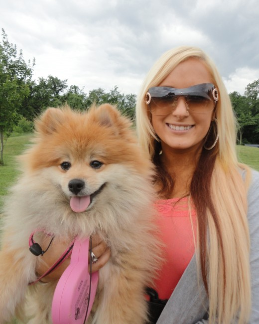 Image of Alyssa Panaia of Chambersburg, Pa., with her Pomeranian, Bentley.