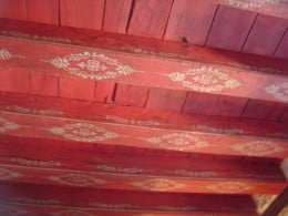 The painted ceiling of the red bedroom