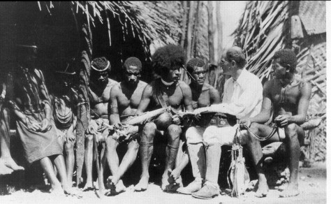 Bronislaw Malinowski, founder of the theoretical orientation known as functionalism, performing fieldwork on the Trobriand Islands.
