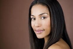 Why do Black women straighten their hair?