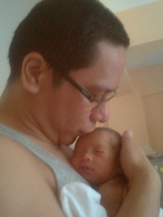 Me and Yna.  A few days after her birth.