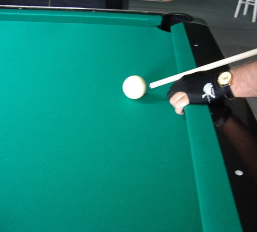 Photo 7:  The snag with gripping the cushion is the tendency to raise your cue to get even more leverage.  This can cause a bouncing cue ball or a ripped baize.