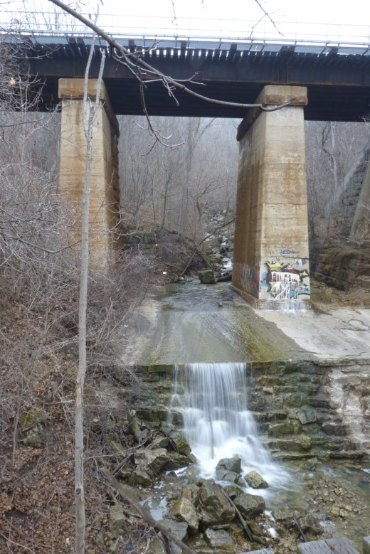Lower Sydenham Falls as it is today with a new railway bridge built on top of the creek at same location as in 1908 postcard.