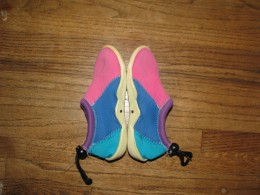 Swimming shoes showing dots inside near the bottom