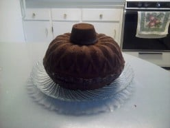 Inverting the cupcake onto the bundt cake helps the pumpkin take shape!