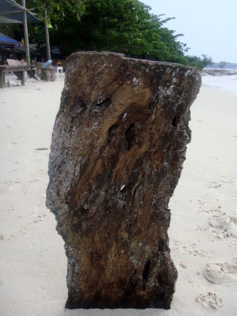 White Sand in Contrast to Wooden Post