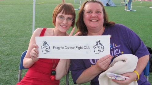 """Our table near the track. We had a """"spin the wheel"""" game for a dollar to raise money for the American Cancer Society"""