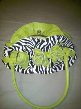This Lime Zebra Purse gives a punch of color to a simple white tunic over black leggings!