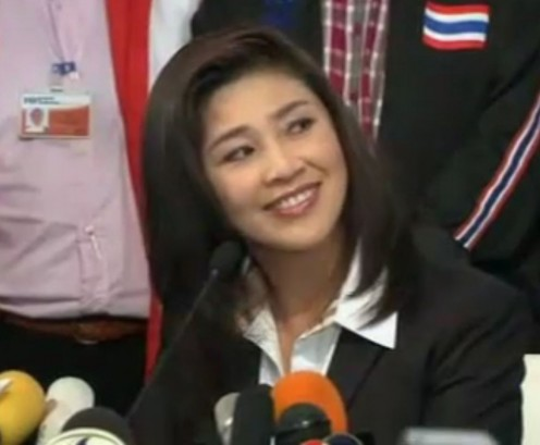 At her first public appearance as new Prime Minister Yingluck Shinawatra; here fielding a potentially difficult questions and win all out.