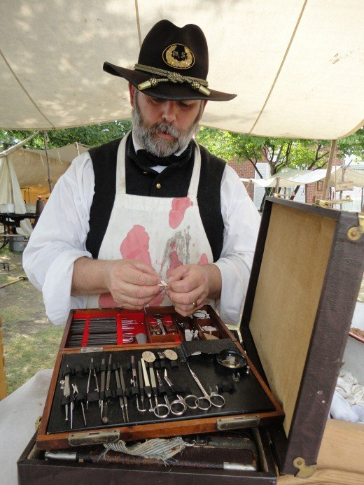 Maj. John Hill Brinton, M.D. as portrayed by Doug Decker of Hollidaysburg, Pa.  He is examining his eye surgical kit.