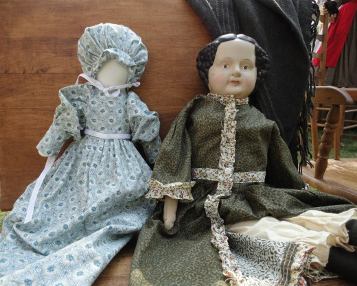 Image of dolls typical of the mid 1800's