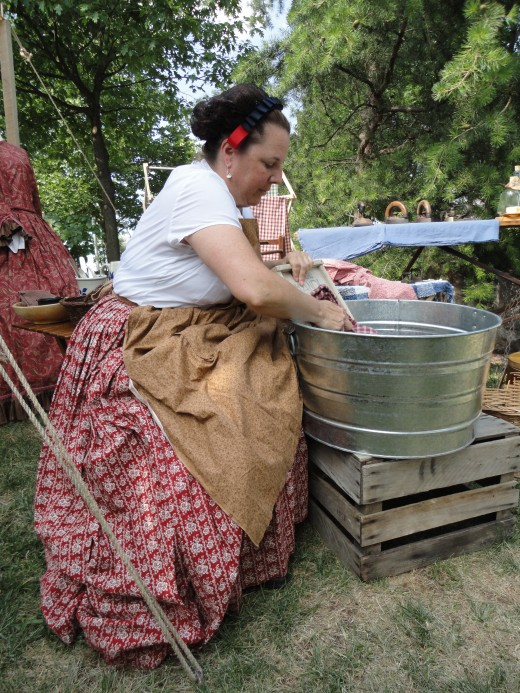 A civilian washer woman as portrayed by Cheri Gainor of Frederick, Md.  She is also a member of the Civil War Heritage Foundation.