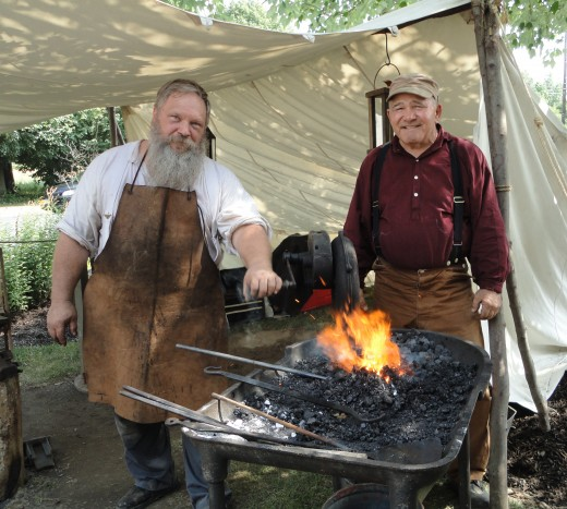 From left, image of Bill Clemens and Tom Anderson, both of Colombia, Pa., portraying blacksmiths from the Civil War era.