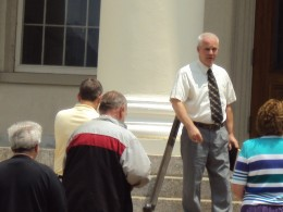 Pastor praying at courthouse claiming Bellefonte for God's glory