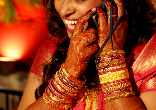 Newly Wed Indian Bride in USA talking on a mobile VOIP