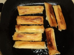 Flipped over lumpia cooking