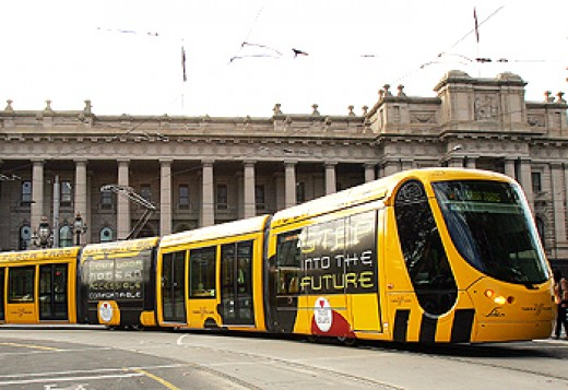 Tram on Bourke Street with the Parliament of Victoria in the background.