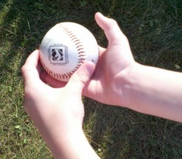 The boys learned to catch a ball with both hands.