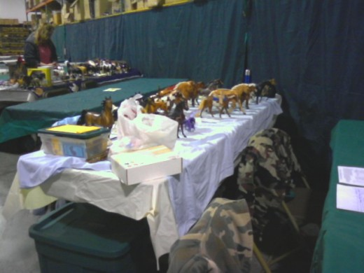 A table-length view at a model horse show. These are only some of the models I have amassed in the years I've been collecting.