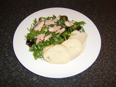 The rainbow trout can firstly be skinned and flaked before being scattered over the salad